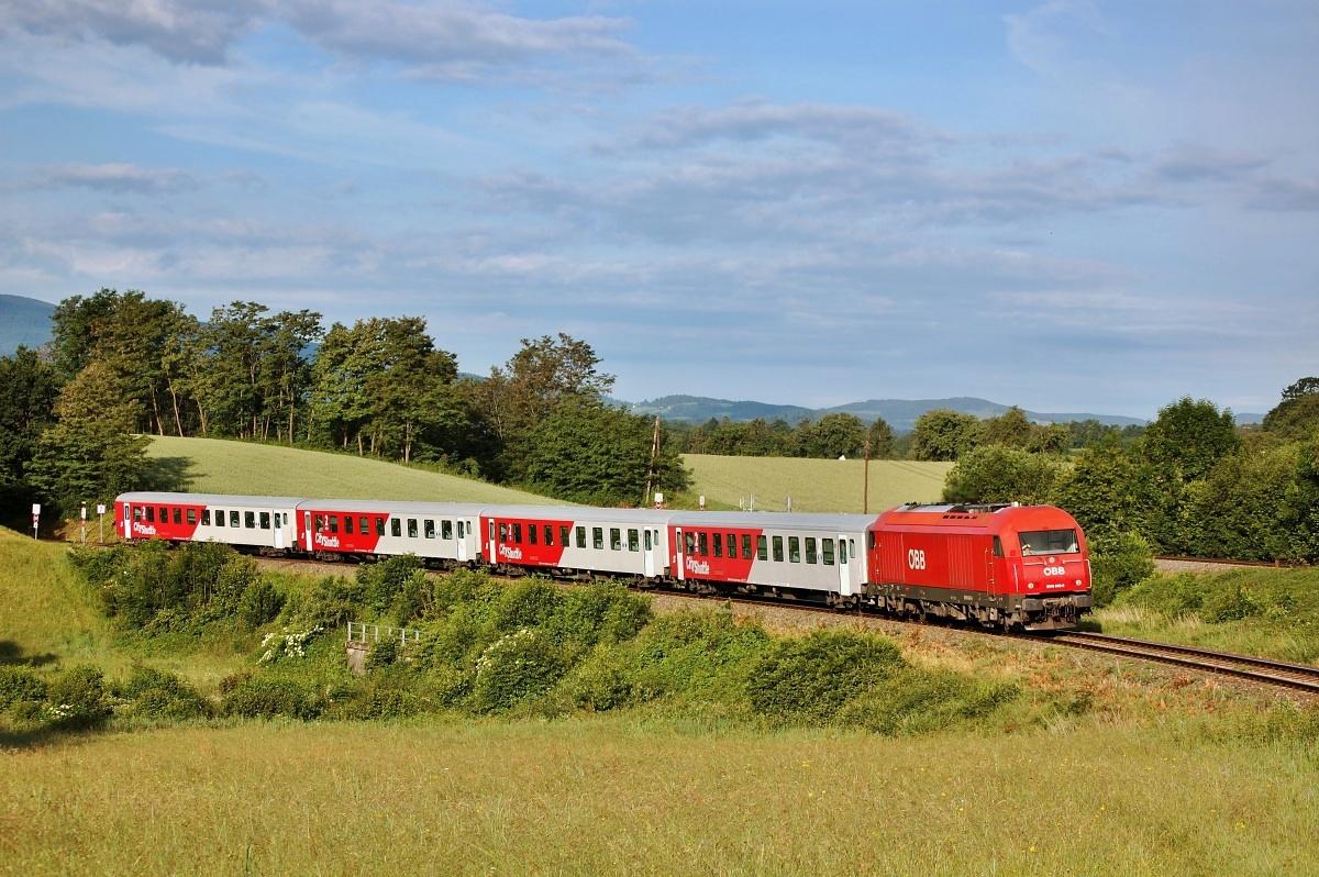 Herkules 2016.043 s vlakem REX 2796 z Oberwartu zachycený před stanicí Friedberg dne 08.06.2009